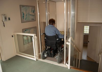 roll-through-wheel-chair-lift-at-the-top-of-stairs-going-down