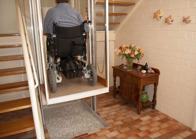 roll-through-wheel-chair-lift-going-up-to-the-next-level